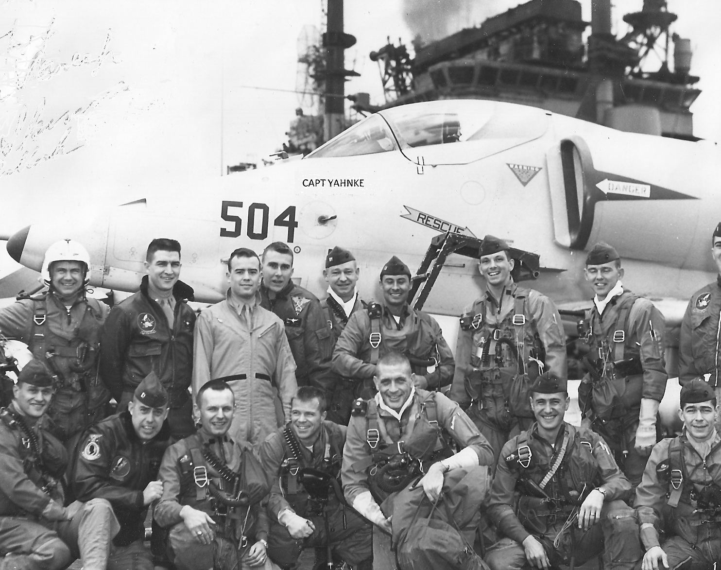 The pilots posing in front of an aircraft