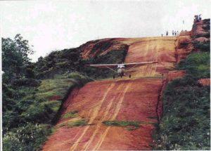 Airplane landing on dirt runway