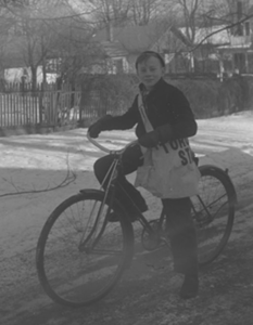 Young Roger on a bicycle