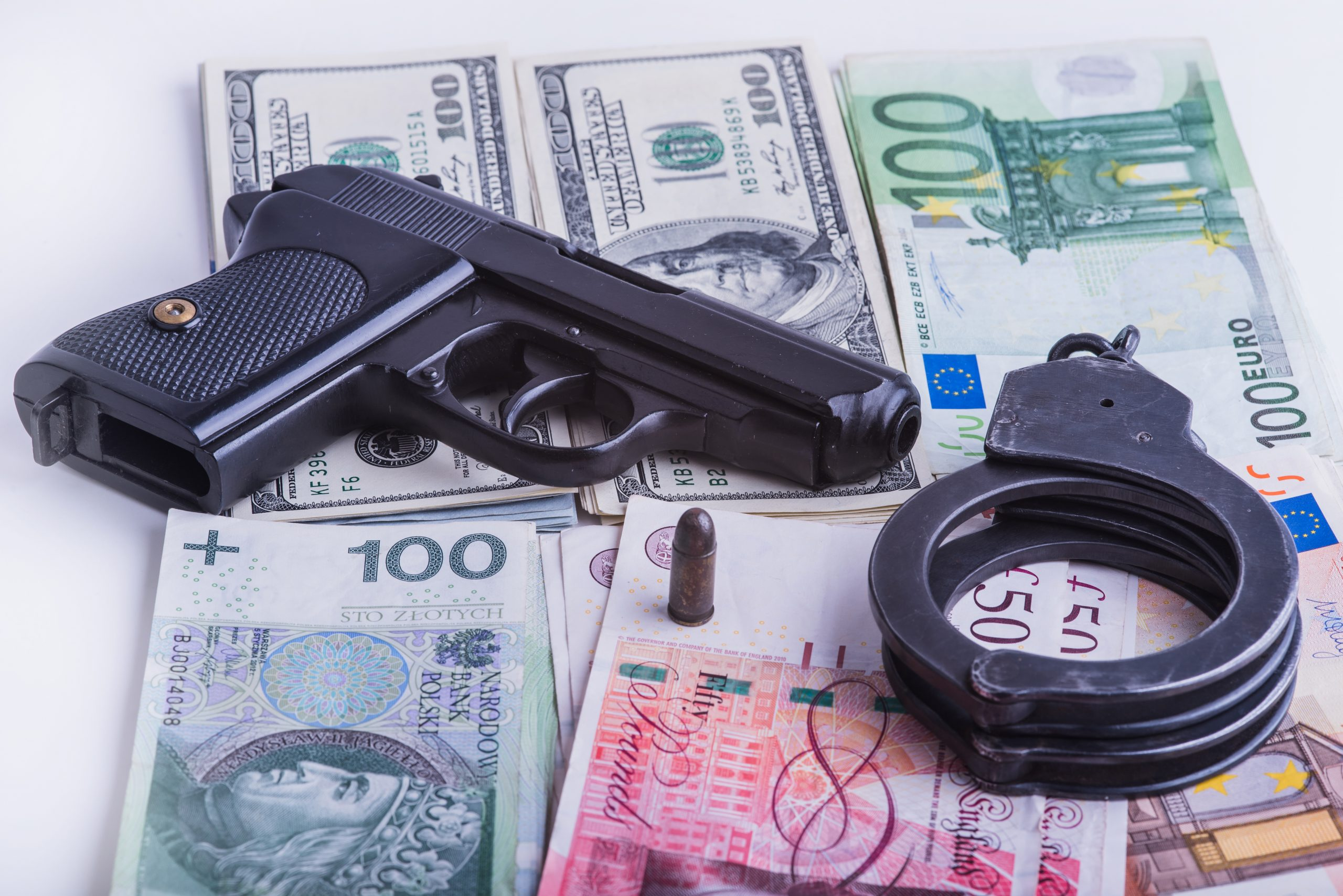 Gun, handcuffs and money representing Rogers hard times in Columbia